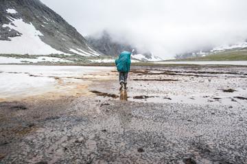 Mari backpacker walking in remote field