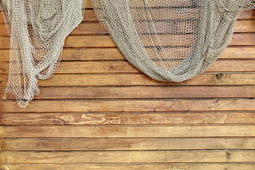 Hanging Fishnet on Rustic Wood Wall