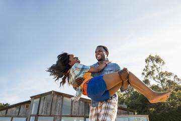African American man carrying girlfriend