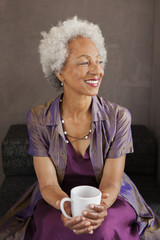 African American woman drinking cup of coffee
