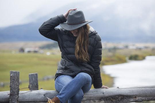 Caucasian woman sitting at rural river