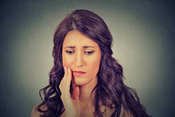woman with sensitive toothache crown problem about to cry from pain