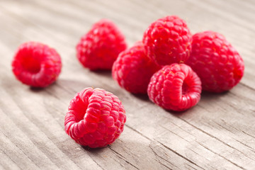 Red Raspberries on wooden background. Close up, high resolution product. Harvest Concept