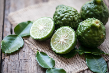 bergamot on sackcloth and wooden background