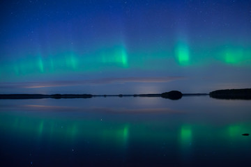 Scenic view of a lake landscape with northern lights