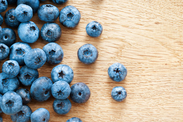 Blueberries on wooden background. Close up, top view, high resolution product. Harvest Concept