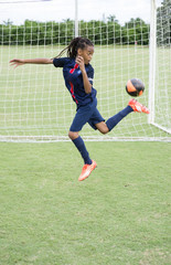 Soccer player practicing rainbow flick on field