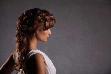 Portrait beautiful woman with elegant white dress grunge wall background