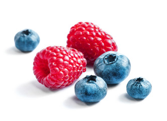 Blueberries and raspberries on white background. Close up, top view, high resolution product. Harvest Concept