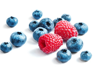 Blueberries and raspberries on white background. Close up, high resolution product. Harvest Concept