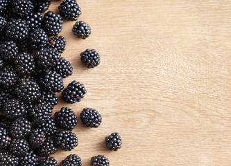 Blackberries on wooden background. Close up, top view, high resolution product. Harvest Concept
