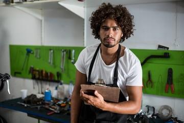 Bike mechanic holding clipboard