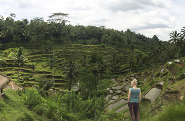 Caucasian tourist admiring rural rice terrace