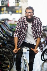 Cool hipster riding a bicycle