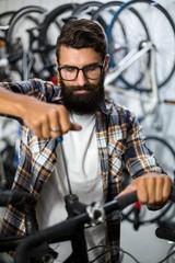 Bike mechanic checking at bicycle
