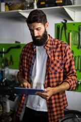 Bike mechanic using tablet computer