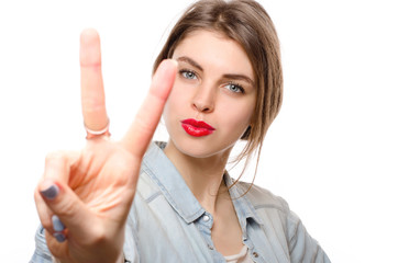 Happy beautiful young woman showing two fingers or victory gesture, isolated over white background