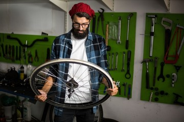 Bike mechanic looking at wheel