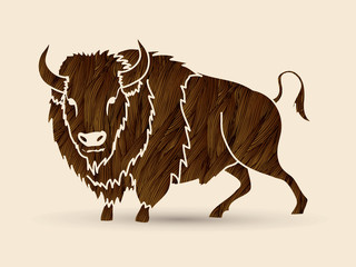 Buffalo standing designed using brown grunge brush graphic vector.