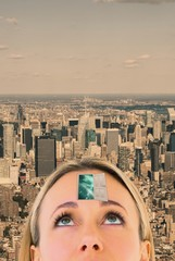 Composite image of close up of blonde woman looking up