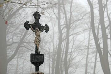 Crucifix . Crucifix and autumn landscape. Crucifix in fog.