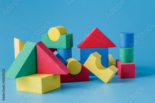 The toy castle from color blocks on  blue background