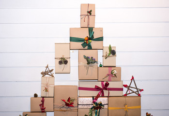 Gift box on the white wall.