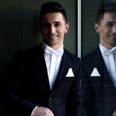 Elegant smiling man in a tuxedo