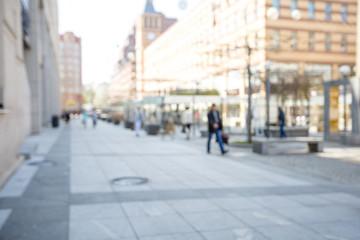 people walking on a city street