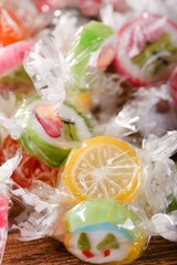 Pile of candies with fruit motifs in cellophane