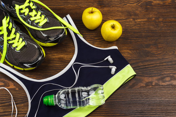 Sneakers, headphones and sports bra