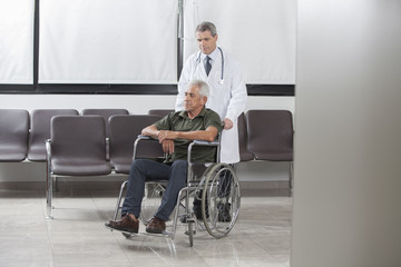 Doctor consulting with a patient in a wheelchair