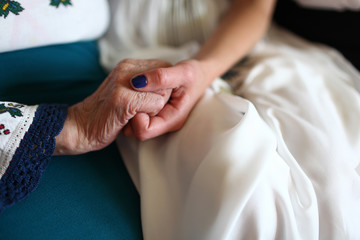 The palms of bride and her grandmother