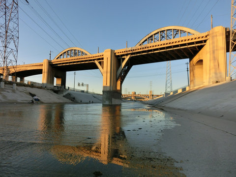 Beautiful bridge over LA river canal at dusk with reflection - landscape color photo