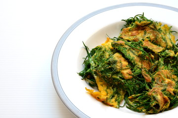 Cha-om Omelet in white plate(Acacia Pennata Omelet); Thai traditional food