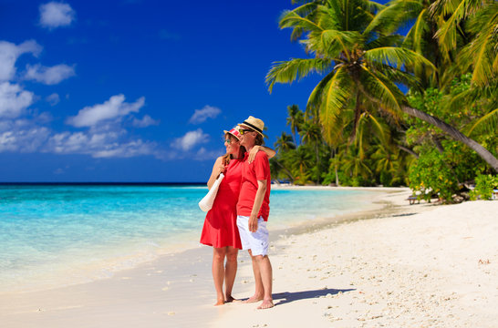 happy loving couple on summer beach
