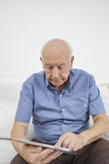 Old man using a Tablet