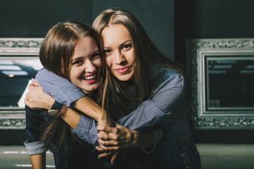 Women hugging in restaurant