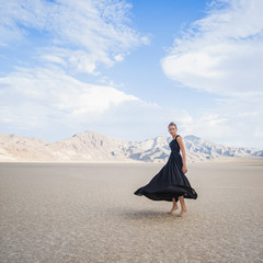 Hispanic woman dancing in remote desert