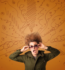 Excited young woman with extreme hairtsyle and hand drawn lines