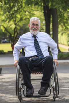Caucasian businessman in wheelchair outdoors