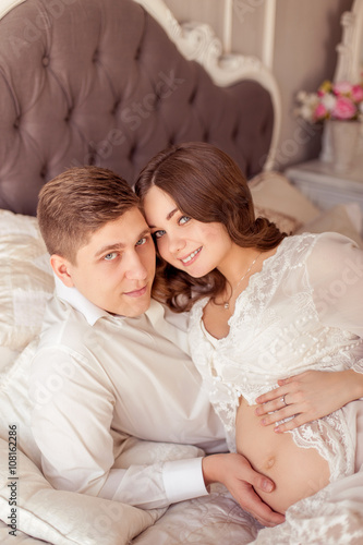 Loving Husband Gently Hugging His Pregnant Wife Happy Family In