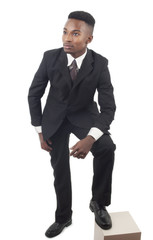 young business man on white background suit and tie