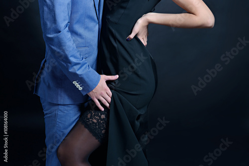 228d6d6ccf Beautiful lady in dress with guy in suit. Young couple is hugging each  other. Portrait of girl with attractive body and boy indoors in passionate  pose.