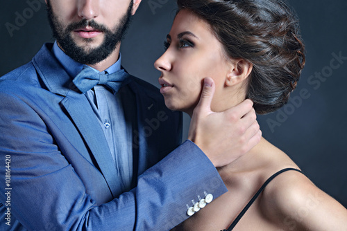 f3b314a055 Portrait of beautiful lady with handsome guy in suit. Young couple is  hugging each other