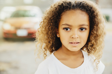 Mixed race girl with serious expression