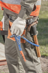 Contractor operating a power tool