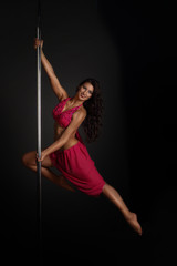 Woman performing pole dance