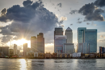 London skyline on a cloudy day at sunset seen from across the river Thames, Canary Wharf is London's financial district a place where the world's greatest corporation and banks do business