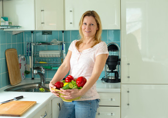 blond woman standing in the kitchen
